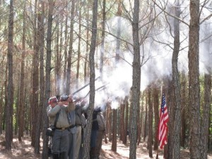 A military gun salute by Civil War re-enactors is performed at a ceremony in Richmond County when tombstones for five Union Cavalry foragers killed in March 1865 finally marked their graves in October 2010.