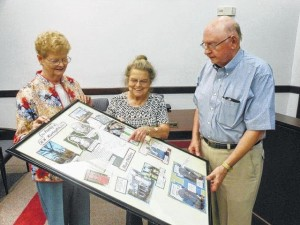 May MacCallum, left, and Pat Franklin, center, of Richmond County Historical Society genealogy, review portions of the presentation on the Harrington family Sept. 21 at Rockingham City Hall with Dr. John Stevenson, society president.