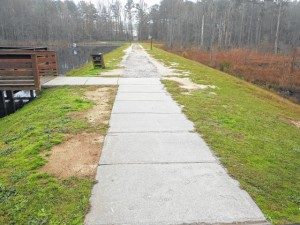 Originally, a road was on top of the Hinson Lake dam. Now there is only a hiking and running pathway.